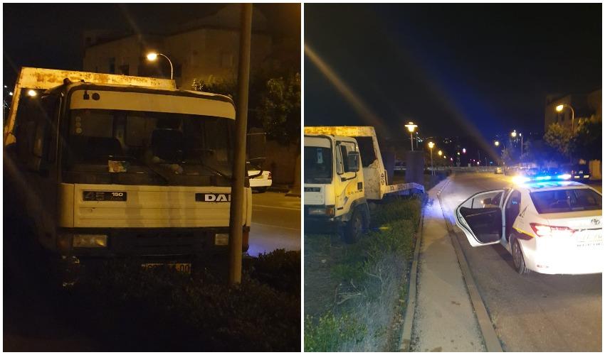 ניידת השיטור והמשאית לאחר שננטשה על ידי הגנב (צילום: פרטי)